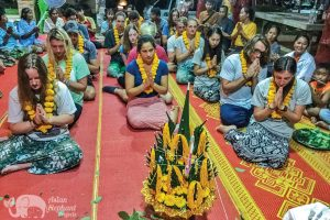 Elephant sanctuary volunteers take part in Buddhist ceremony