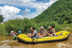 Rafting down the river while on ethical elephant tour in Chiang Mai
